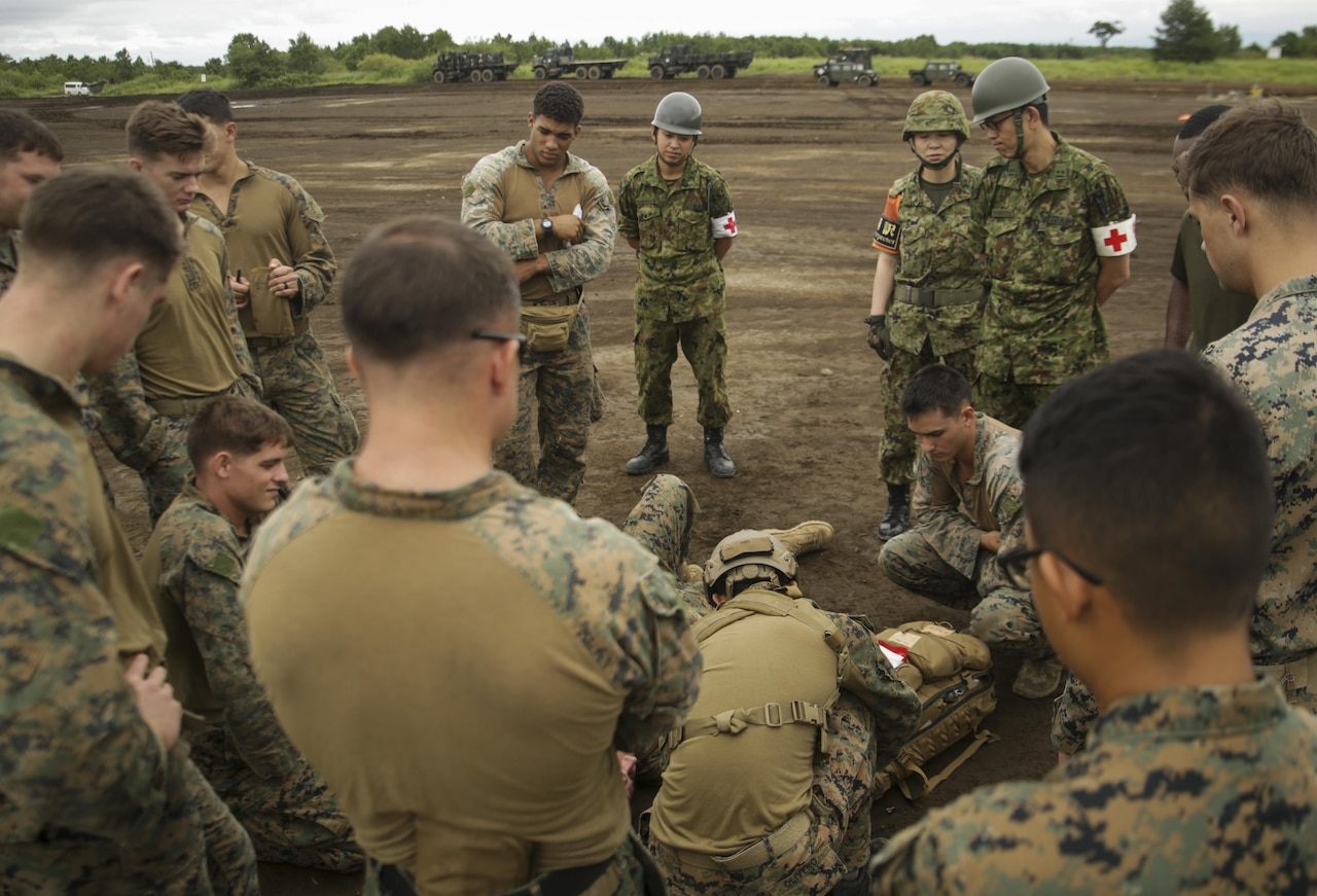 U.S. Marines and Japan Ground Self-Defense Force troops learn tactical combat casualty care