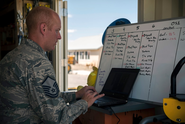U.S. Air Force Master Sgt. Benjamin Reed, the operations management superintendent with the 182nd Civil Engineer Squadron, Illinois Air National Guard, updates the unit's construction progress on a situation report in Crow Agency, Mont., July 27, 2017. The squadron helped build homes for Crow Nation veterans as part of the Department of Defense's Innovative Readiness Training civil-military relations program. (U.S. Air National Guard photo by Tech. Sgt. Lealan Buehrer)