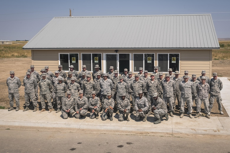 Airmen and soldiers with U.S. National Guard pose for a group photo in Crow Agency, Mont., Aug. 4, 2017. The Illinois Air National Guard's 182nd Civil Engineer Squadron, augmented by 182nd Force Support Squadron services specialists, 182nd Medical Group medics and soldiers with the Montana Army National Guard's 230th Vertical Engineer Company, helped build homes for Crow Nation veterans as part of the Department of Defense's Innovative Readiness Training civil-military relations program. (U.S. Air National Guard photo by Tech. Sgt. Lealan Buehrer)
