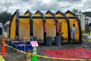 An inflatable mass decontamination shower.