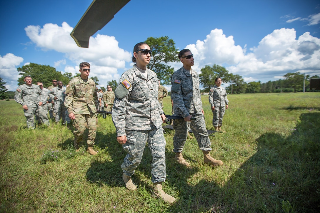 U.S. Army Reserve Soldiers from the 328th Combat Support Hospital (CSH) and 349th CSH practice hot-load litter techniques during Combat Support Training Exercise (CSTX) 86-17-02 at Fort McCoy, Wis., August 10, 2017. Hot-load litter techniques involve actual simulated casualties being carried on the litter. CSTX includes more than 12,000 service members from the Army, Navy, Air Force and Marine Corps as well as from six countries. CSTX is a large-scale training event where units experience tactical training scenarios specifically designed to replicate real-world missions. (U.S. Army Reserve photo by Spc. John Russell/Released)