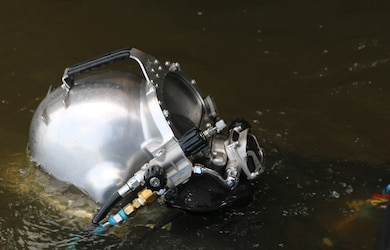 A diver from the Little Rock District U.S. Army Corps of Engineers prepares to go underwater during a maintenance operation at Millwood Dam July 15.