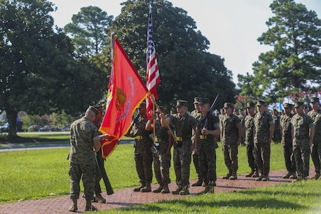 Col. David Owen and Sgt. Maj. Rene Salinas unveil the new unit colors for II Marine Expeditionary Force Information Group during a redesignation ceremony, during which II Marine Expeditionary Force Headquarters Group was renamed II MEF Information Group at Camp Lejeune, N.C., July 21, 2017. The unit's redesignation to II MIG is the first visible action complimentary to the forthcoming capabilities that support the Commandant's priorities to modernize the force and develop increased capability in the information environment. Owen is the Commanding Officer and Salinas is the Sergeant Major of II MIG.