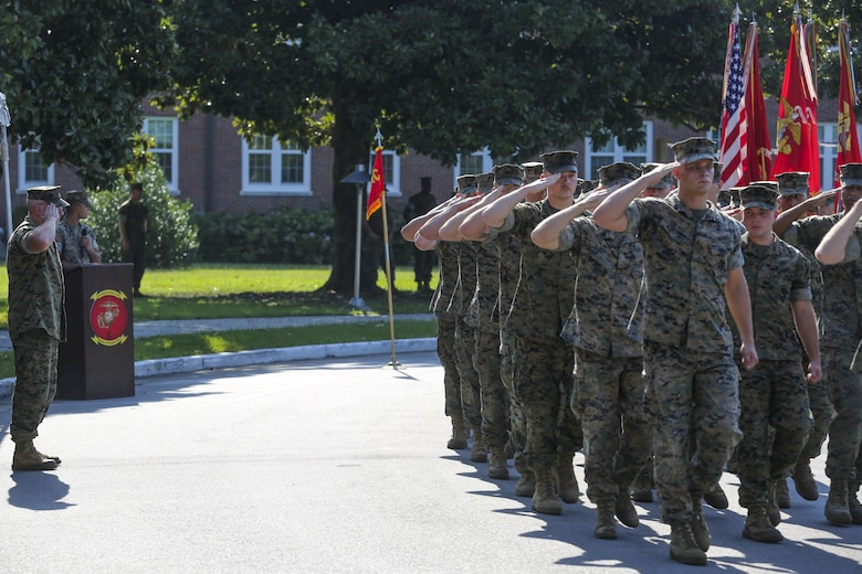 Col. David Owen salutes Marines for a pass in review at the conclusion of a redesignation ceremony, during which II Marine Expeditionary Force Headquarters Group was renamed II MEF Information Group at Camp Lejeune, N.C., July 21, 2017. The unit's redesignation to II MIG is the first visible action complimentary to the forthcoming capabilities that support the Commandant's priorities to modernize the force and develop increased capability in the information environment.