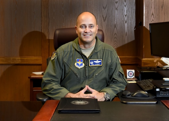 U.S. Air Force Col. Eric Carney, 97th Air Mobility Wing commander, poses at his desk, July 28, 2017, Altus Air Force Base, Oklahoma. Carney took command of the 97th AMW in June 2017 and wants to Airmen to concentrate on safety on and off the job and understanding the importance of each job. (U.S. Air Force photo by Senior Airman Nathan Clark/Released)