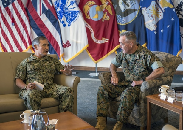 Adm. Harry Harris, Commander of U.S. Pacific Command (PACOM), has a conversation with Marine Corps Gen. Joseph Dunford, Jr., Chairman of the Joint Chiefs of Staff, at PACOM Headquarters, Aug. 11, 2017. Hawaii is the first stop in Dunford's travel of the PACOM area of responsibility.