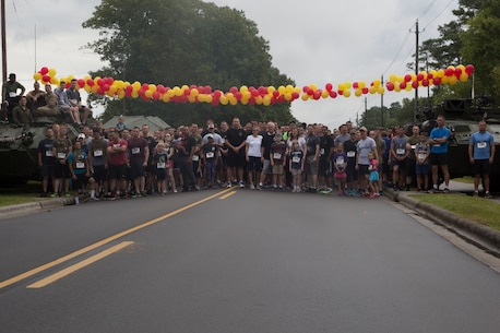 Run to Remember participants pose for a group photo before beginning the race at Camp Lejeune, N.C. Aug 5, 2017. The run is held every first Saturday of August in honor of Sgt. Lucas Pyeatt, a cryptologic linguist killed in action during Operation Enduring Freedom, February 2011, and other service members killed in action.