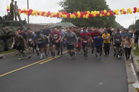 Participants take off from the starting line during the Run to Remember memorial run at Camp Lejeune, N.C. Aug 5, 2017. The run is held every first Saturday of August in honor of Sgt. Lucas Pyeatt, a cryptologic linguist killed in action during Operation Enduring Freedom, February 2011, and other service members killed in action.