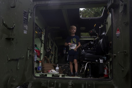 A boy tours a light armored vehicle during the Run to Remember memorial run at Camp Lejeune, N.C. Aug 5, 2017. The run is held every first Saturday of August in honor of Sgt. Lucas Pyeatt, a cryptologic linguist killed in action during Operation Enduring Freedom, February 2011, and other service members killed in action.