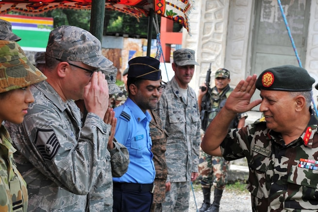 In this file photo, Nepalese Army Maj. Gen. Baldev Mahat greets Operation Pacific Angel-Nepal members during the opening ceremony in Manahari, Nepal, Sept. 8, 2014. PACANGEL supports U.S. Pacific Command's capacity-building efforts by partnering with other governments, non-governmental agencies and multilateral militaries in the respective region to provide medical, dental, optometry and engineering assistance to their citizens.