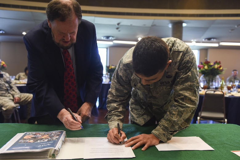 Howard Taylor, San Angelo Museum of Fine Arts director, and U.S. Air Force Col. Ricky Mills, 17th Training Wing commander, sign a STARBASE memorandum at the San Angelo Museum of Fine Arts, San Angelo, Texas, Aug. 11, 2017. The memorandum signaled the official STARBASE agreement between San Angelo and Goodfellow Air Force Base. The STARBASE curriculum focuses on exposing youth to innovative hands-on activities in science, technology, engineering and mathematics based on the physics of flight. (U.S. Air Force photo by Airman 1st Class Chase Sousa/Released)