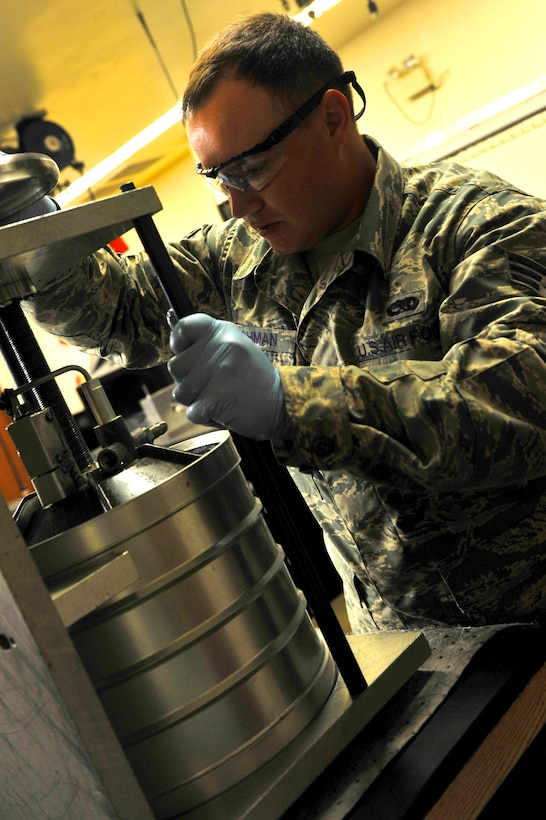 Senior Airman Seven Lohman, 56th Component Maintenance Squadron hydraulics journeyman, disassembles an A-10 Thunderbolt reservoir at Luke Air Force Base, Ariz. August 8, 2017. The reservoir stores the pressure fluid on the aircraft allowing it to turn and steer.  (U.S. Air Force photo/Airman 1st Class Pedro Mota)