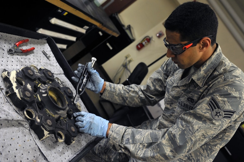 Senior Airman Adam Amosa, 56th Component Maintenance Squadron hydraulics journeyman, disassembles an A-10 Thunderbolt landing gear brake at Luke Air Force Base, Ariz. August 8, 2017. The break pad was disassembled to inspect and determine if the piece was serviceable.  (U.S. Air Force photo/Airman 1st Class Pedro Mota)