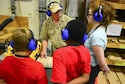 Kevin Watt, Wood Craft Center manger, teaches kids how to make a cutting board at Fairchild Air Force Base, Washington, Aug. 11, 2017. The Fairchild Youth Center hosted a week-long wood working camp where kids worked on projects with the help from the Fairchild Wood Craft Center Aug. 7 to 11. (U.S. Air Force photo/Senior Airman Janelle Patiño)