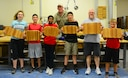 Kevin Watt, Wood Craft Center manager, and the wood-working camp participants pose for a photo after making their cutting boards at Fairchild Air Force Base, Washington, Aug. 11, 2017. The Youth Center partnered with the Wood Craft Center to host a total of two, week-long wood working camps to offer the classes to more kids. (U.S. Air Force photo/Senior Airman Janelle Patiño)