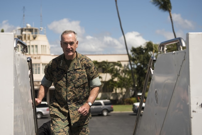 Marine Corps Gen. Joseph F. Dunford Jr., chairman of the Joint Chiefs of Staff, boards an aircraft before departing Joint Base Pearl Harbor-Hickam, Aug. 12, 2017.