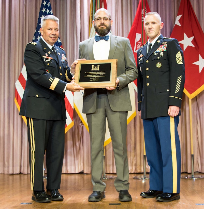 Lt. Gen. Todd T. Semonite, the 54th Chief of Engineers and Commanding General of the U.S. Army Corps of Engineers (USACE), and Command Sergeant Major Bradley Houston, the 13th Command Sgt. Maj. of USACE, stand on stage with awardees at the National Awards Ceremony in Washington, D.C., Aug. 2, 2017. The National Awards Ceremony is an annual event that recognizes employees for their achievements. (U.S. Army Photo by Leanne Bledsoe
