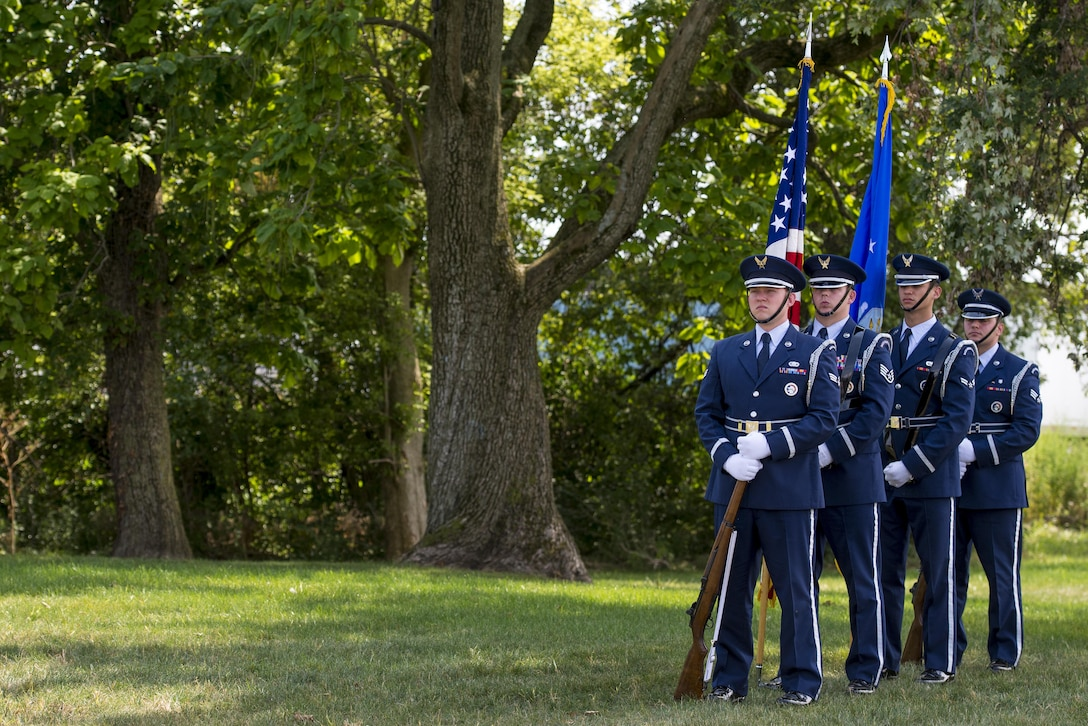 Members of the Wright-Patterson Air Force Base honor guard prepare to present the colors during a ceremony dedicating an Ohio highway to a special operations hero, Aug. 14, 2017. Six miles of County Highway 121 was dedicated in Master Sgt. William L. McDaniel II's namesake, a Special Tactics pararescueman who was killed when the MH-47 Chinook helicopter he was in crashed in the Philippines Feb. 22, 2002. (U.S. Air Force photo by Wesley Farnsworth)
