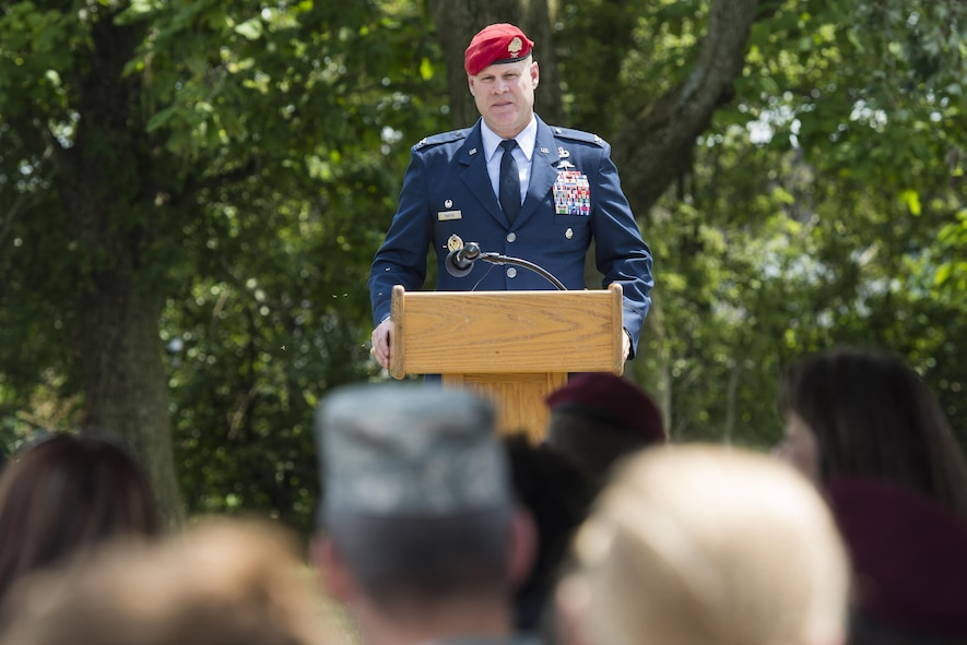 Col. Michael Martin speaks during a ceremony dedicating a six-mile stretch of Highway 121 in honor of Master Sgt. William L. McDaniel II's namesake in Greenville, Ohio, Aug. 14, 2017. McDaniel was a a Special Tactics pararescueman who was killed when the MH-47 Chinook helicopter he was in crashed in the Philippines Feb. 22, 2002. A pararescueman's unique technical rescue skill sets are utilized during humanitarian and combat operations; they deploy anywhere, anytime, employ air-land-sea tactics into restricted environments to authenticate, extract, treat, stabilize and evacuate injured or isolated personnel. (U.S. Air Force photo by Wesley Farnsworth)