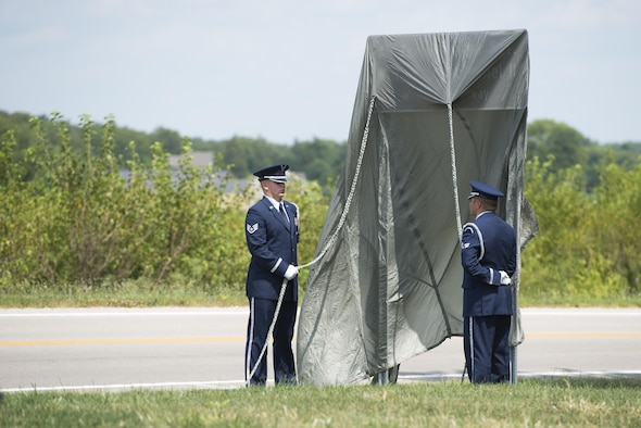 Members of the Wright-Patterson Air Force Base honor guard stand with an unveiled highway sign during a highway dedication ceremony for Master Sgt. William L. McDaniel II, in Greenville Ohio, Aug. 14, 2017. Six miles of County Highway 121 was dedicated in McDaniel's namesake, a Special Tactics pararescueman who was killed when the MH-47 Chinook helicopter he was in crashed in the Philippines Feb. 22, 2002. (U.S. Air Force photo by Wesley Farnsworth)