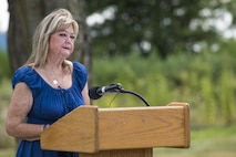Sheila McDaniel, the mother of Master Sgt. William L. McDaniel II, provides remarks following a ceremony dedicating a six-mile stretch of Highway 121 in honor of her son's namesake, in Greenville, Ohio, Aug. 14, 2017. McDaniel was part of a joint, special operations team who were infiltrating an island in Southern Philippines when the MH-47 Chinook helicopter he was in crashed into the Sulu Sea Feb. 22, 2002. (U.S. Air Force photo by Wesley Farnsworth)