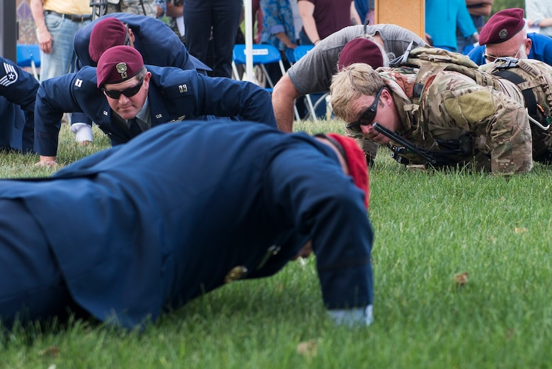 Col. Michael Martin, commander of the 24th Special Operations Wing, leads memorial push-ups following a ceremony dedicating a six-mile stretch of Highway 121 in honor Master Sgt. William L. McDaniel II's namesake, in Greenville, Ohio, Aug. 14, 2017. McDaniel was part of a joint, special operations team who were infiltrating an island in Southern Philippines when the MH-47 Chinook helicopter he was in crashed into the Sulu Sea Feb. 22, 2002. (U.S. Air Force photo by Wesley Farnsworth)