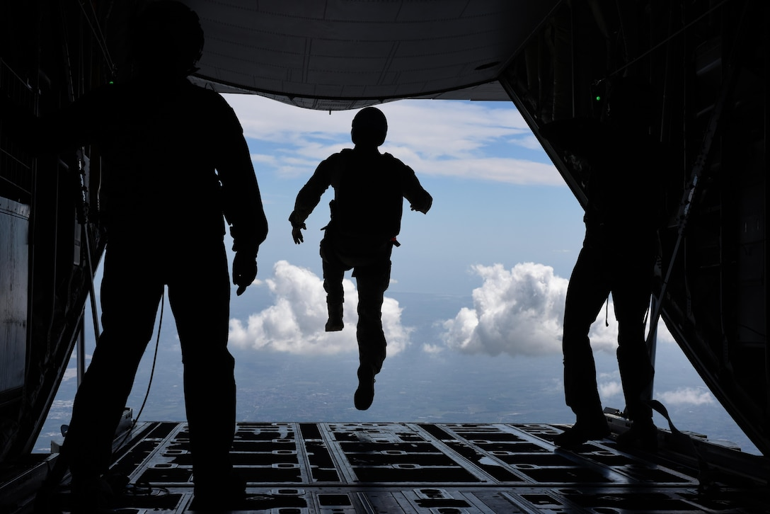 An Airman assigned to the 57th Rescue Squadron begins a freefall jump from a 37th Airlift Squadron C-130J Super Hercules during exercise Ares Shadow, Aug. 11. Ares Shadow is a 48th Fighter Wing-led personnel recovery exercise involving Airmen from across U.S. Air Forces in Europe, Air Force Special Operations Command, as well as members of the Italian armed forces. (U.S. Air Force photo/Airman 1st Class Eli Chevalier)