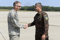 U.S. Air National Guard Col. James P. Ryan, the 157th Air Refueling Wing commander, shakes hands with Brig. Gen. Guillermo Adolfo Herrador Pena, the chief of the Salvadoran armed forces, on August 10, 2017 at Pease Air National Guard Base, N.H. Senior members of the Salvadoran armed forces visited Pease as part of an effort to build upon the existing bilateral relationship between the United States and El Salvador. (U.S. Air National Guard photo by Staff Sgt. Kayla Rorick)