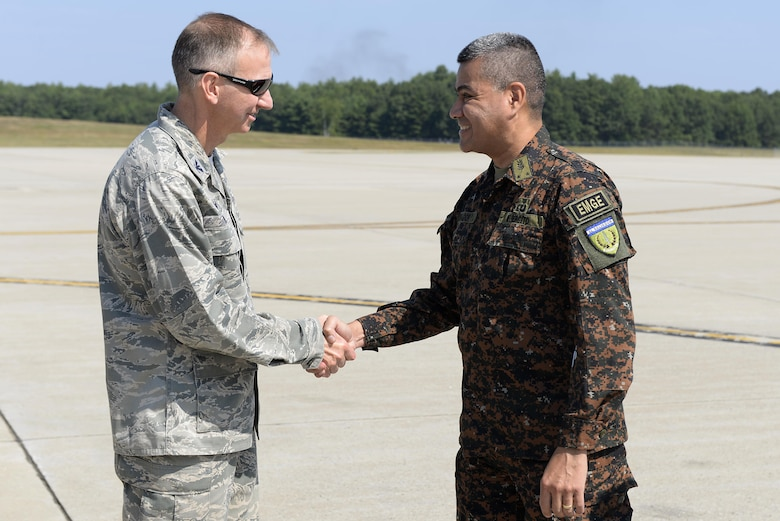U.S. Air National Guard Col. James P. Ryan, the 157th Air Refueling Wing commander, shakes hands with Brig. Gen. Guillermo Adolfo Herrador Pena, the chief of the Salvadoran armed forces, on August 10, 2017 at Pease Air National Guard Base, N.H.