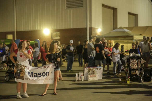 Families and friends wait for the Marines and Sailors of 3rd Battalion, 8th Marine Regiment to arrive at Camp Lejeune, N.C., August 12, 2017. Marines and Sailors returned from a 6-month Unit Deployment Program in Okinawa, Japan. V38 conducted exercises in Okinawa, Mainland Japan, South Korea, Thailand, the Philippines, Guam and other smaller islands. (U.S. Marine Corps photo by Lance Cpl. Leynard Kyle Plazo)