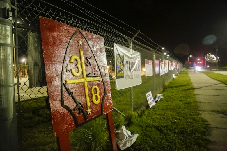 Signs and banners made by friends and families hang on the fences surrounding the compound at Camp Lejeune, N.C., August 12, 2017. Marines and Sailors returned from a 6-month Unit Deployment Program in Okinawa, Japan. V38 conducted exercises in Okinawa, Mainland Japan, South Korea, Thailand, the Philippines, Guam and other smaller islands. (U.S. Marine Corps photo by Lance Cpl. Leynard Kyle Plazo)