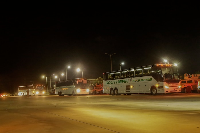 Buses carrying the Marines and Sailors of 3rd Battalion, 8th Marine Regiment arrive to where the families are waiting for them at Camp Lejeune, N.C., August 12, 2017. Marines and Sailors returned from a 6-month Unit Deployment Program in Okinawa, Japan. V38 conducted exercises in Okinawa, Mainland Japan, South Korea, Thailand, the Philippines, Guam and other smaller islands. (U.S. Marine Corps photo by Lance Cpl. Leynard Kyle Plazo)