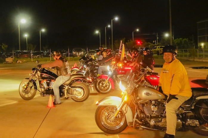 Bikers park their vehicles after escorting the buses carrying the Marines at Camp Lejeune, N.C., August 12, 2017. Marines and Sailors returned from a 6-month Unit Deployment Program in Okinawa, Japan. V38 conducted exercises in Okinawa, Mainland Japan, South Korea, Thailand, the Philippines, Guam and other smaller islands.  (U.S. Marine Corps photo by Lance Cpl. Leynard Kyle Plazo)