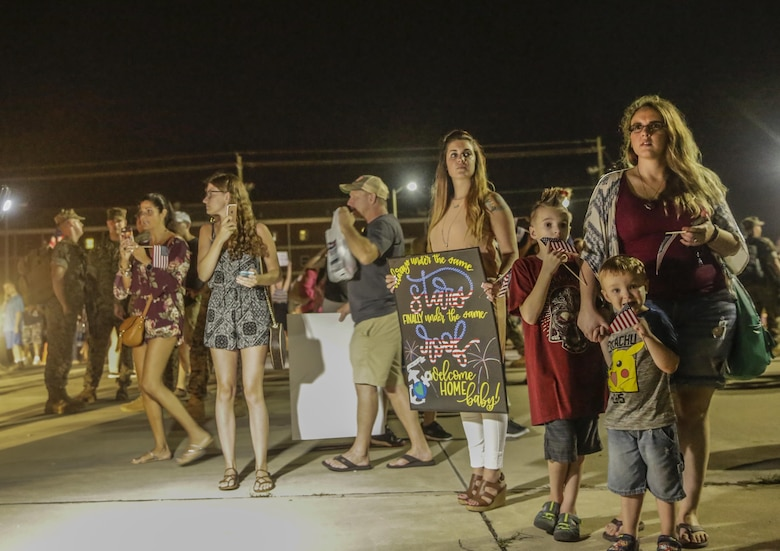Friends and families look for their Marine as they arrive at camp Lejeune, N.C., August 12, 2017. Marines and Sailors returned from a 6-month Unit Deployment Program in Okinawa, Japan. V38 conducted exercises in Okinawa, Mainland Japan, South Korea, Thailand, the Philippines, Guam and other smaller islands. (U.S. Marine Corps photo by Lance Cpl. Leynard Kyle Plazo)