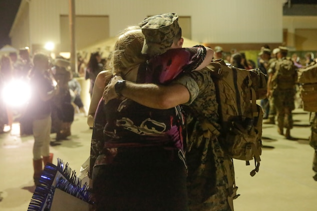A Marine hugs a family member after coming from a deployment, at Camp Lejeune, N.C., August 12, 2017. Marines and Sailors returned from a 6-month Unit Deployment Program in Okinawa, Japan. V38 conducted exercises in Okinawa, Mainland Japan, South Korea, Thailand, the Philippines, Guam and other smaller islands. (U.S. Marine Corps photo by Lance Cpl. Leynard Kyle Plazo)