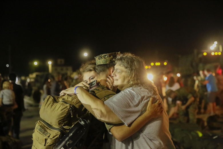 A Marine reunites with his family after returning from a deployment, at Camp Lejeune, N.C., August 12, 2017. Marines and Sailors returned from a 6-month Unit Deployment Program in Okinawa, Japan. V38 conducted exercises in Okinawa, Mainland Japan, South Korea, Thailand, the Philippines, Guam and other smaller islands. (U.S. Marine Corps photo by Lance Cpl. Leynard Kyle Plazo)
