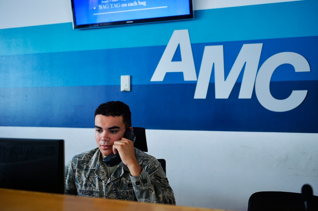 U.S. Air Force Airman 1st Class Cody Nichols, 721st Aerial Port Squadron passenger services agent, answers the phone while working at the passenger service desk on Ramstein Air Base, Germany, Aug. 14, 2017. Space Available, commonly known as Space A, is a program at many U.S. Air Force installations around the world which allows military members, dependents, retirees, and certain civilians to ride an aircraft to a destination at either a very cheap price or no cost at all. (U.S. Air Force photo by Airman 1st Class Joshua Magbanua)