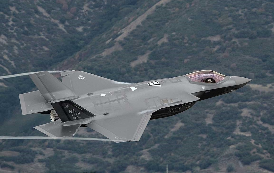 Lt. Col. George Watkins, 34th Fighter Squadron commander, flies his combat-coded F-35A Lightning II aircraft past the control tower on Sept. 17, 2015 at Hill Air Force Base, Utah. During the sortie, the weapon system's first at Hill, Watkins conducted mission qualification training focusing on weapons employment, range familiarization and mission system proficiency. (U.S. Air Force photo/ALEX R. LOYD)