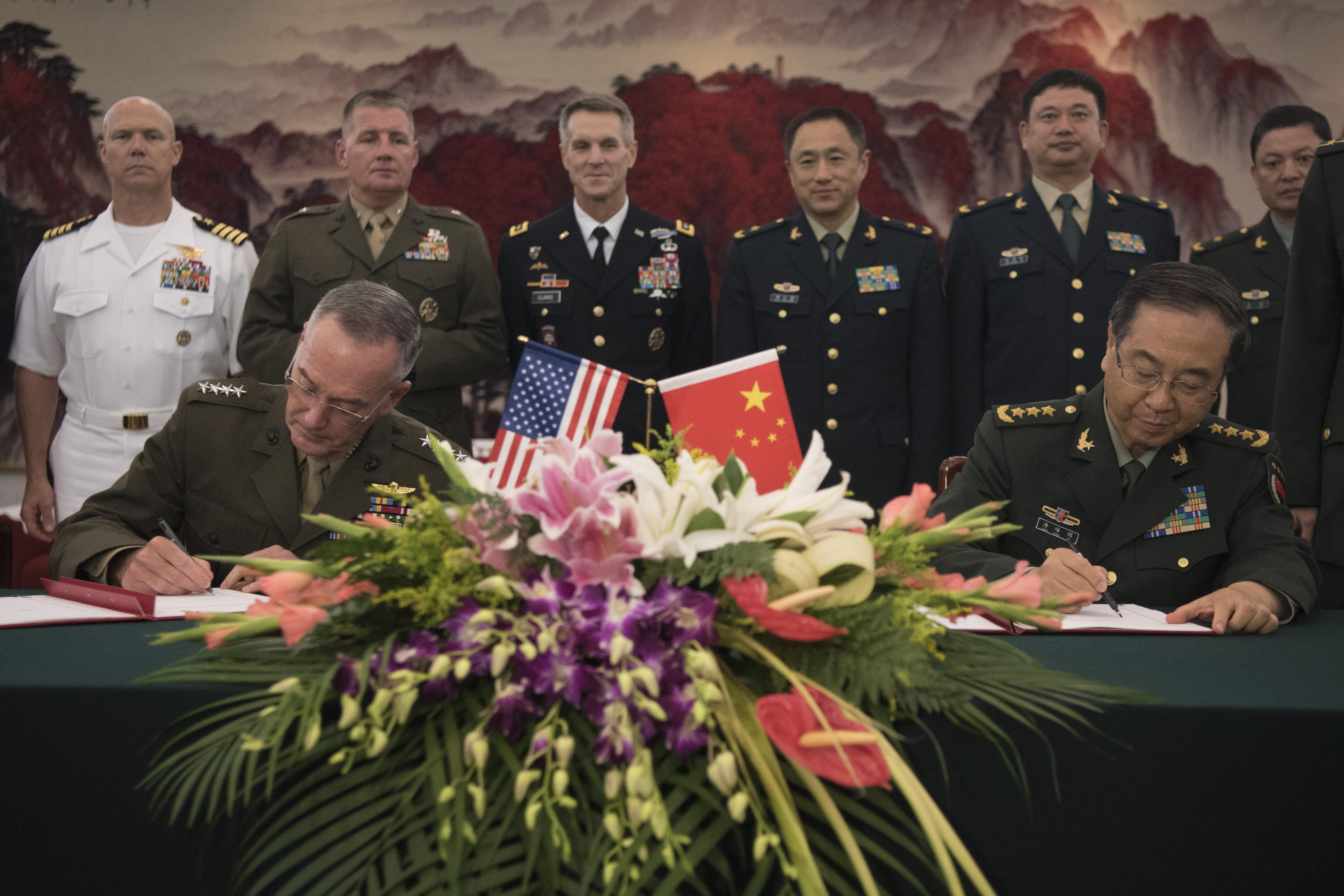 Us Chinese Military Leaders Sign Agreement To Increase