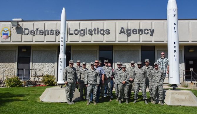 F.E. Warren and Hill Air Force Base's Logistics Officer Association members pose for a photo in front of the Defense Logistics Agency at Hill Air Force Base, Utah, Aug. 10, 2017.