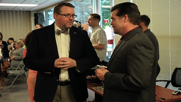 Defense Contract Management Agency Chief of Public Affairs, Mark Woodbury, and Collaboration Portfolio Manager, Joe Rhodes, collaborate communication efforts during the global all hands July 26, 2017 at Fort Lee, Virginia. (DCMA photo by Elizabeth Szoke)
