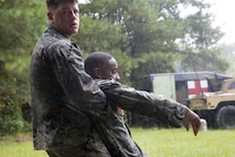 Lance Cpl. Ed Concitts buddy drags a notional casualty during a casualty care evaluation as part of the 2nd Light Armored Reconnaissance Isaak Competition at Camp Lejeune, N.C., August 8, 2017. The Isaak Competition, in honor of Cpl. Garreth Isaak, distinguishes the most proficient scout within the Battalion through a series of events including an endurance course, land navigation, and weapons proficiency. The Marines are with 2nd LAR Battalion. (U.S. Marine Corps photo by Lance Cpl. Gloria Lepko)
