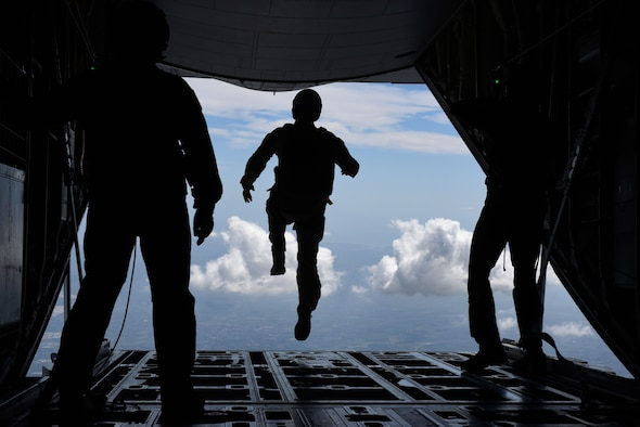 An airman assigned to the 57th Rescue Squadron begins a free fall jump.
