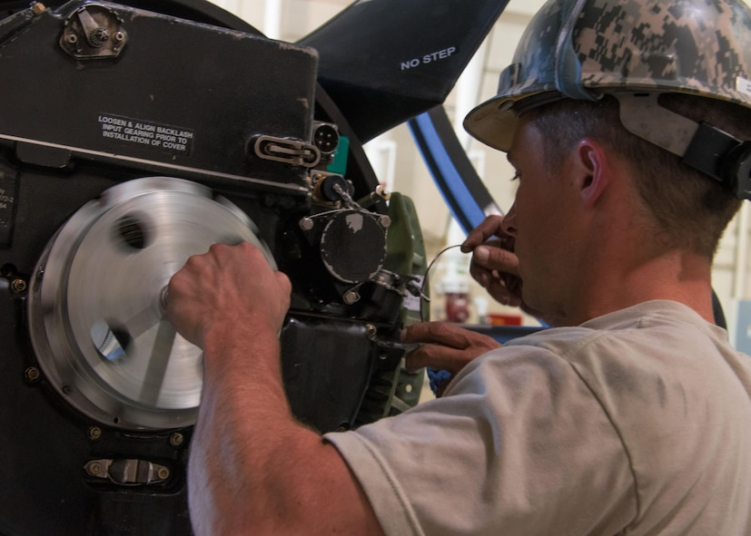 Staff Sgt. Brandon Hightower, a 94th Aircraft Maintenance Squadron aerospace propulsion technician, seats pump housing on a propeller at Dobbins Air Reserve Base, GA. July 26, 2017. Hightower recently joined the Air Force Reserve after serving eight years on active duty. (U.S. Air Force photo/Staff Sgt. Andrew Park)