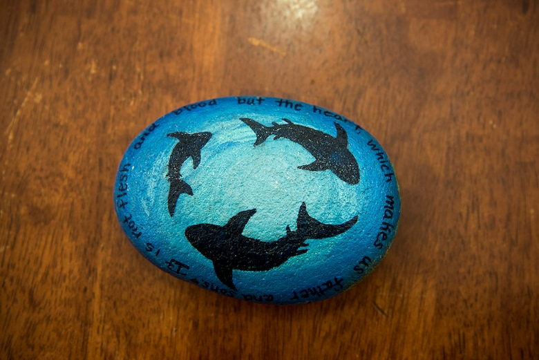 Members of PAFB rocks! paint rocks to display and hide around Peterson Air Force Base, Colo., for others to find. Aug. 4, 2017. This rock was painted by Andrea Collis for a shark week themed week of July 31. (U.S. Air Force photo by Steve Kotecki)