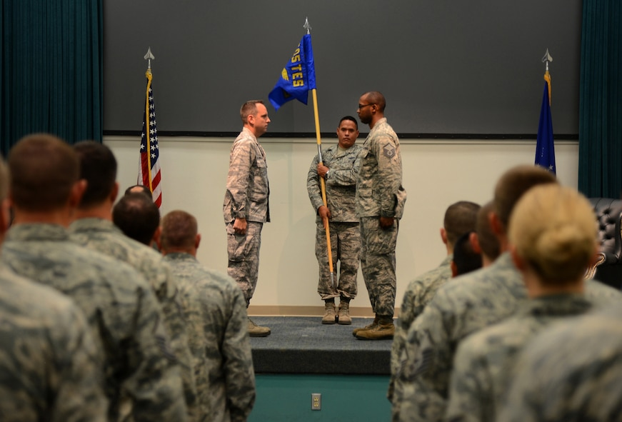 The guidon for the 605th Test and Evaluation Squadron, Detachment 1, is officially unfurled during a Flag Uncasing Ceremony in Fannin Hall Aug. 7.