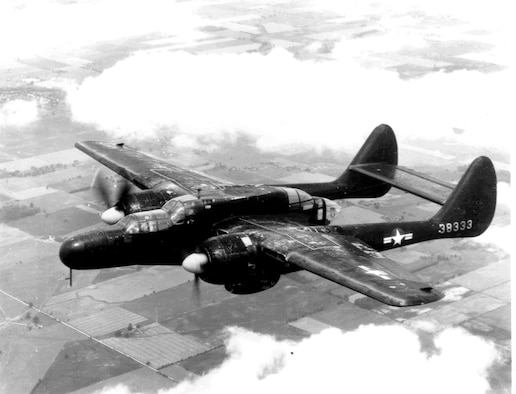 An all-black P-61A Black Widow captured in-flight shows the design features of the aircraft type during service with the Army Air Corps.