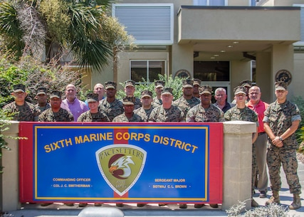 US. Marines with 6th Marine Corps District (6MCD) pose for a group photo during the Supply Conference aboard Marine Corps Recruit Depot Parris Island, South Carolina, Aug. 15, 2017. The conference provided training in Financial Management, Logistics, Facilities and Supply to ensure that applicable regulations are understood and enforced. Supply personnel from across the District came to the conference to gain additional information to help them support the recruiters in their local area. (U.S. Marine Corps photo by Lance Cpl. Jack A. E. Rigsby)