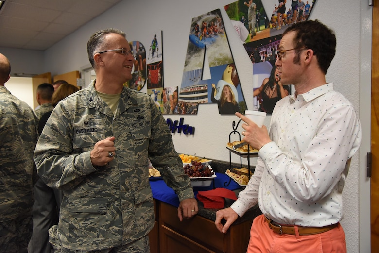 Col. John DeStazio, 2nd Air Force Technical Training Operations Center commander, and Ryan Goldin, Florence Gardens-Community Development vice president, engage in conversation during an honorary commanders 81st Mission Support Group orientation tour in the Sablich Center Aug. 10, 2017, on Keesler Air Force Base, Miss. The honorary commander program is a partnership between base leadership and local civic leaders to promote strong ties between military and civilian leaders. (U.S. Air Force photo by Kemberly Groue)