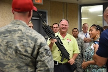 Terry Powell, Edgewater Mall manager, holds a weapon while touring the 81st Security Forces Squadron indoor firing range during an honorary commanders 81st Mission Support Group orientation tour Aug. 10, 2017, on Keesler Air Force Base, Miss. The honorary commander program is a partnership between base leadership and local civic leaders to promote strong ties between military and civilian leaders. (U.S. Air Force photo by Kemberly Groue)